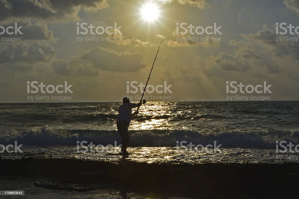 Angler on the beach royalty-free stock photo
