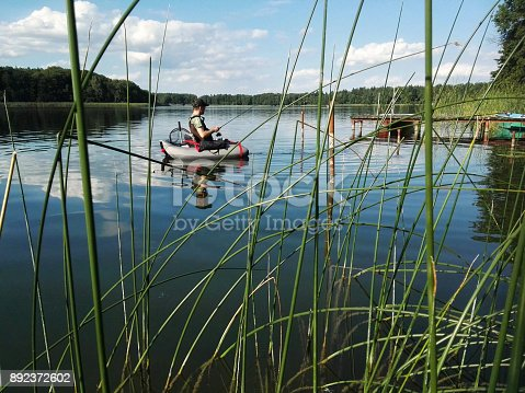 istock Angler with Belly Boat 892372602