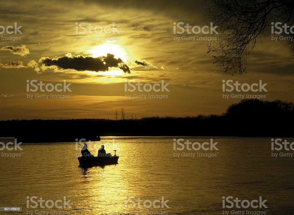 anglers in the sunset stock photo