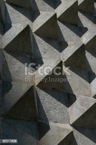 Shadows and angles on a wall on the side of a castle in Portugal.