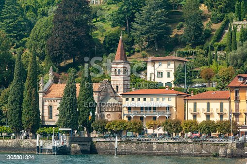 People can be seen on the waterfront near the Anglican Church of the Ascension in Cadenabbia on Lake Como, Italy. This is one of the few English speaking churches in Italy.