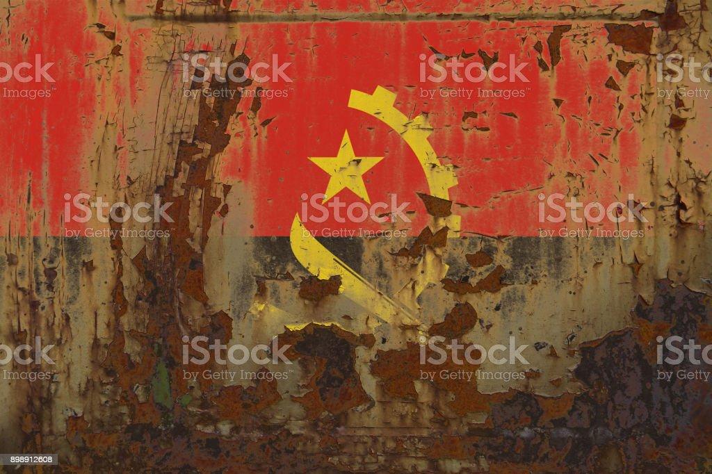 Angola Flag on a Dirty Rusty Grunge Metallic Surface stock photo