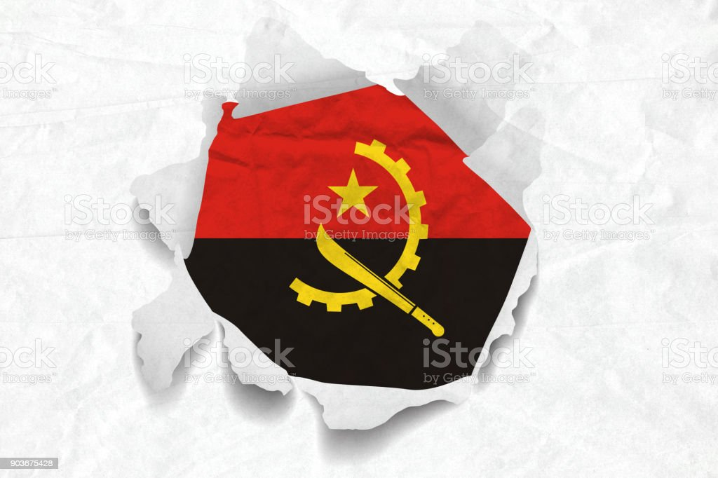 Angola Flag on a Torned Wrinkled Crumbled Grunge Paper stock photo