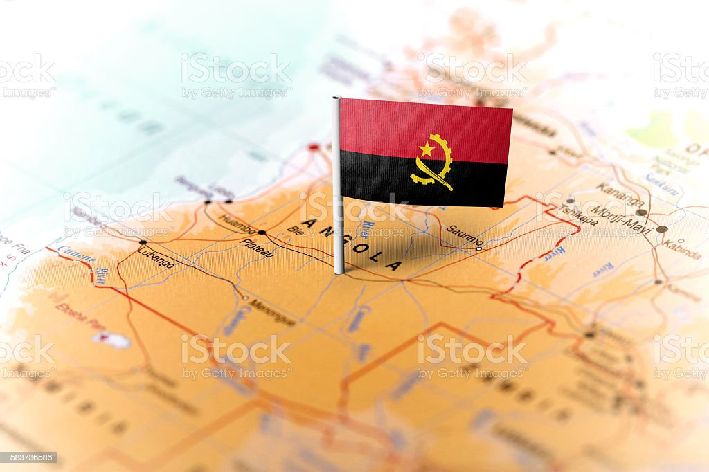 Angola pinned on the map with flag - foto de acervo