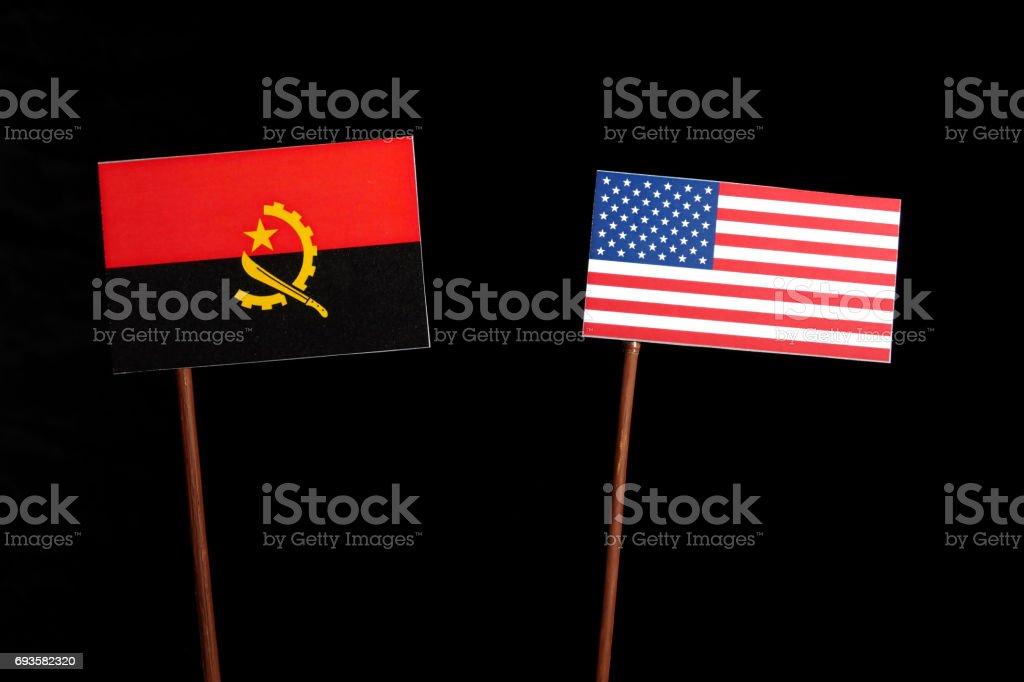 Angolan flag with USA flag isolated on black background stock photo