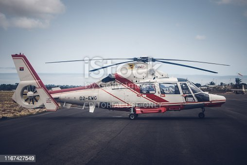 Angolan helicopter Super Puma L2 getting ready for the flight to the offshore oil field on Soyo town airdrome
