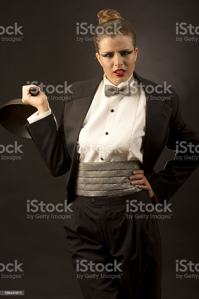 Angri tuxedo woman with a pam stock photo