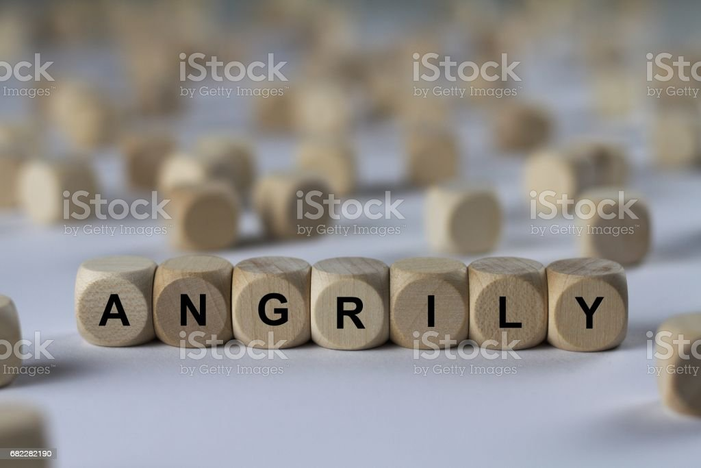 angrily - cube with letters, sign with wooden cubes stock photo