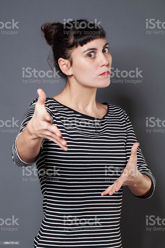 angry 20s woman trying to control her body language stock photo