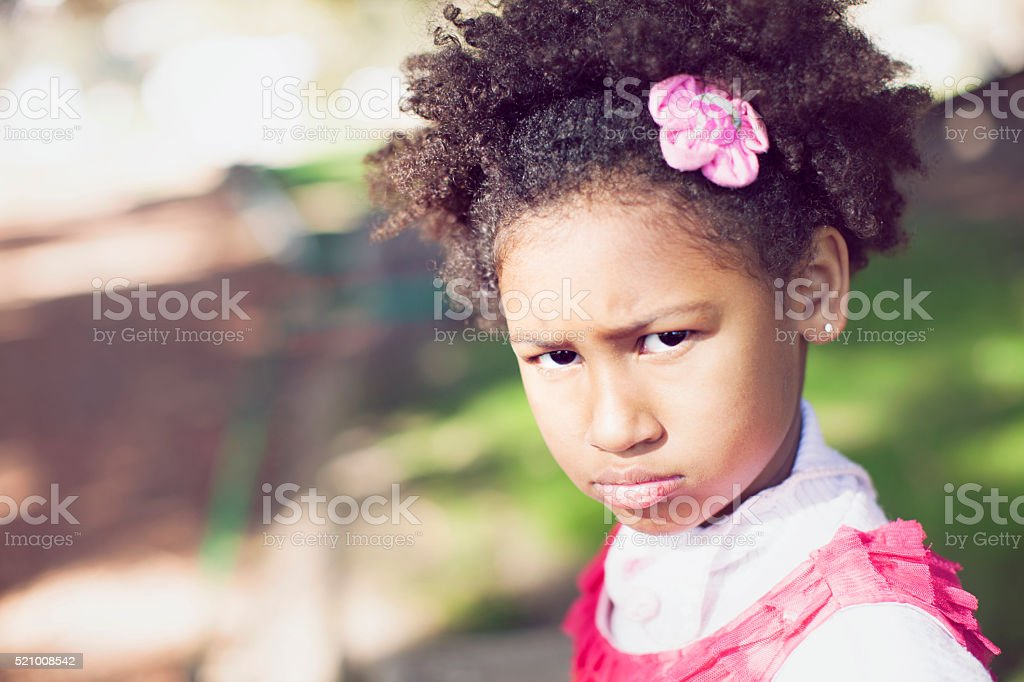 Angry African American Girl Looking at Camera stock photo