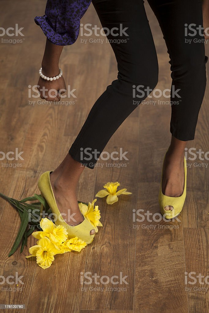 Angry African American girlfriend stomps flowers royalty-free stock photo