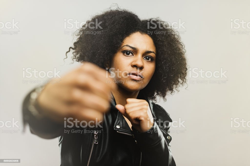 Angry african woman fighting stock photo