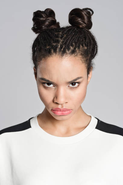 Angry afro american teenager girl stock photo