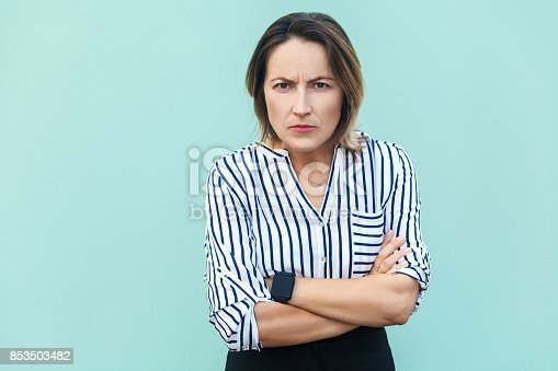 istock Angry, aggressive. Handsome adult elegant woman looking at camera with angry face. 853503482
