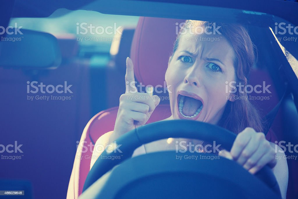 angry aggressive woman driving car stock photo