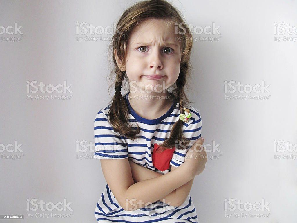 Angry and cute girl stock photo