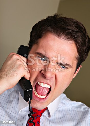 463813207 istock photo Angry and irate telephone shouting businessman 92029922
