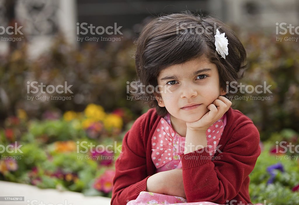 Angry and Thoughtful Caucasian Little girl in the Garden royalty-free stock photo