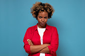istock Angry annoyed african woman keeping arms crossed and staring at camera with sceptical and distrustful look 1281396573