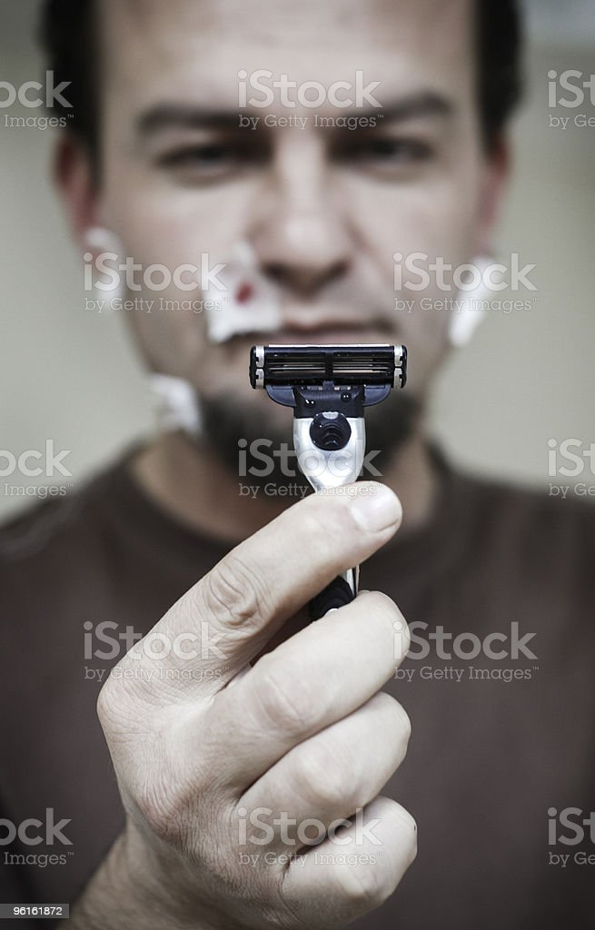 angry at the blunt razor blade royalty-free stock photo