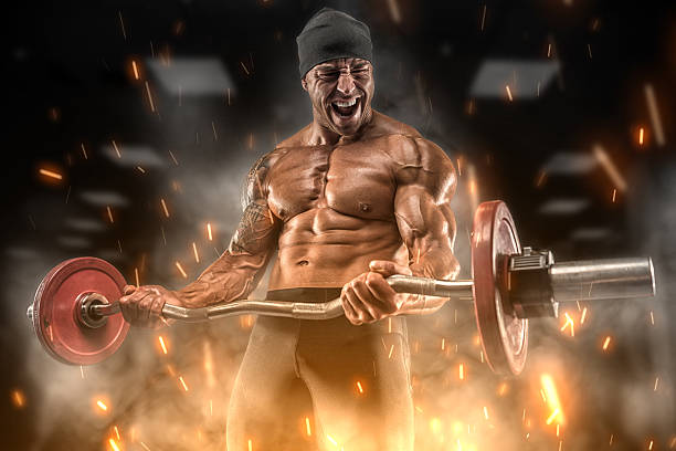 Angry athlete trains in the gym stock photo