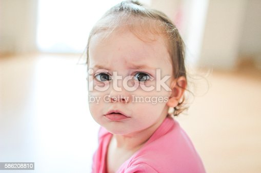 istock Angry baby face 586208810