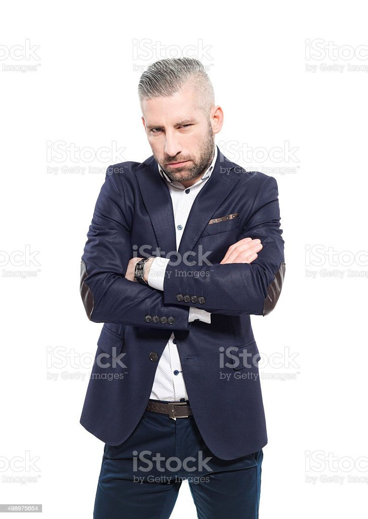 Angry bearded grey hair businessman Portrait of angry bearded grey hair businessman, looking at camera with arms crossed. Studio shot, one person, isolated on white. 2015 Stock Photo
