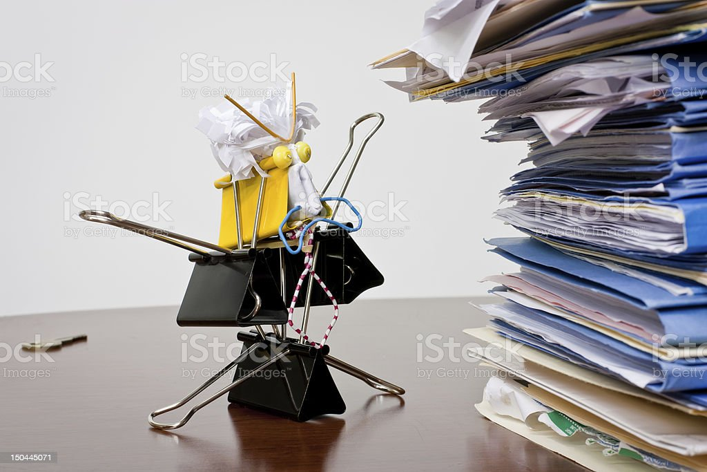 Angry Binder Clip Business Man W/ Stack of files stock photo
