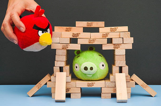 Angry Bird game with soft toys and Jenga bricks stock photo