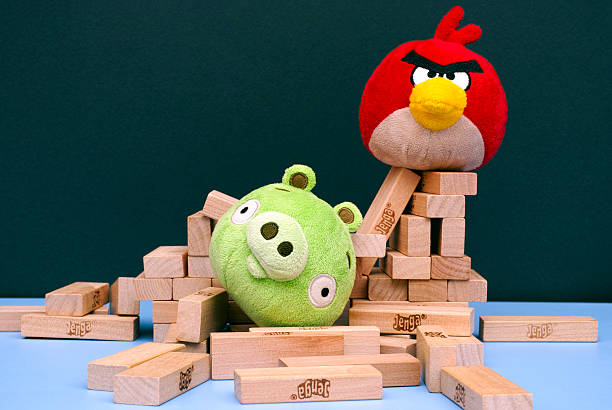 Angry Bird vs. Bad Piggies soft toys and Jenga bricks stock photo