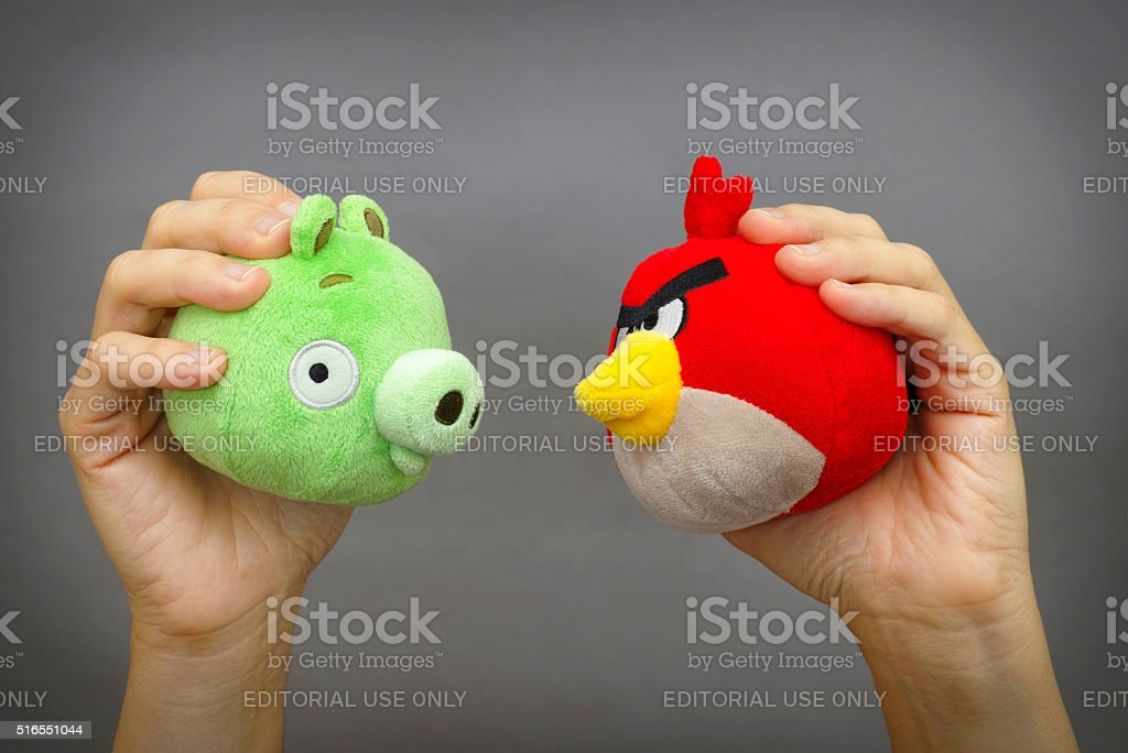 Angry Birds vs. Bad Piggies stock photo