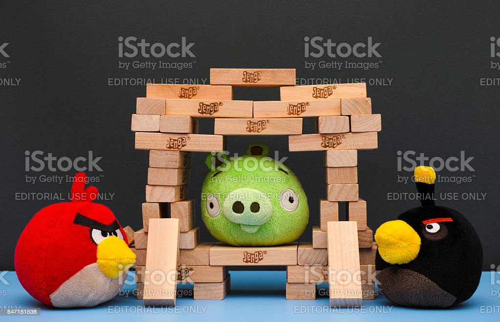 Angry Birds with Bad Piggy in Jenga castle stock photo