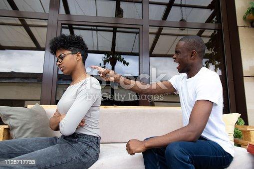 istock Angry black husband negative emotionally shouting at wife 1128717733