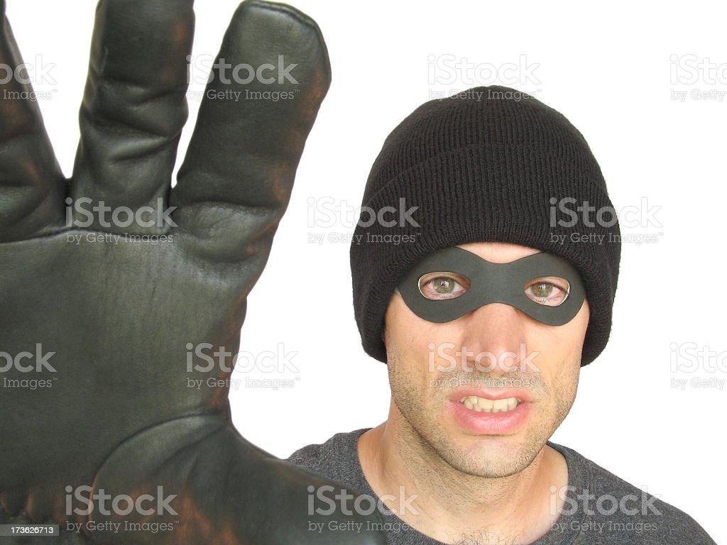 Angry Black-masked Burglar, Thief, or Mugger Grabbing at You royalty-free stock photo