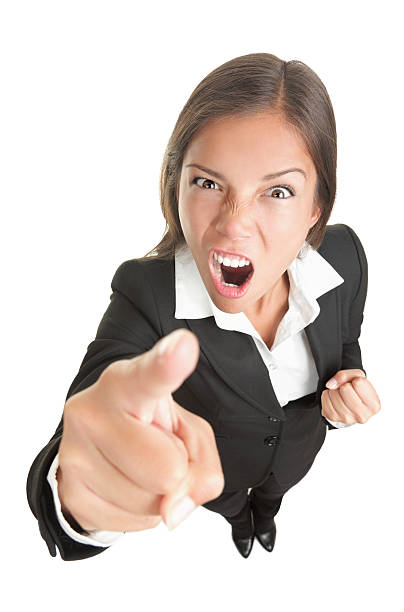 Angry boss business woman isolated Angry funny businesswoman isolated on white background looking and pointing upset at camera. See more: fish eye lens stock pictures, royalty-free photos & images
