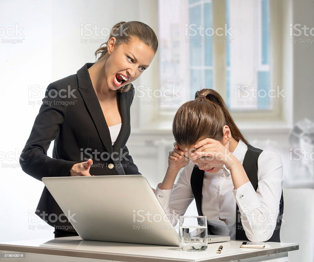 Angry boss shouts at a junior stock photo