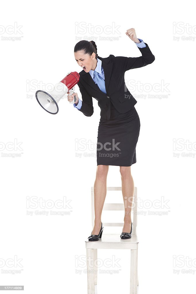 angry boss with megaphone on chair royalty-free stock photo