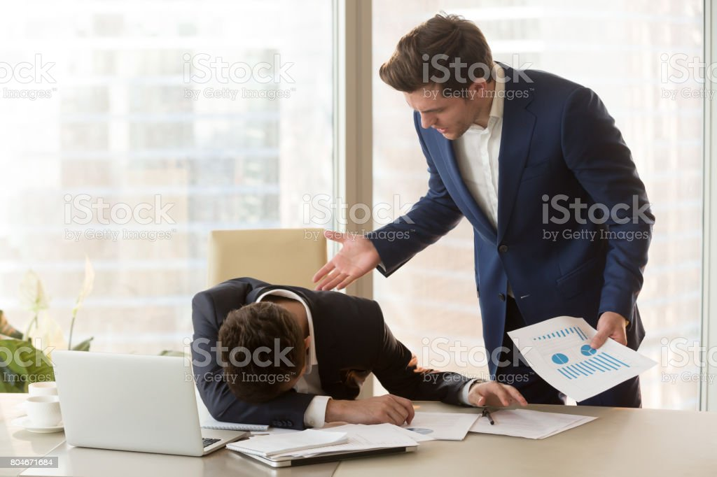Angry boss yelling at depressed employee for failure, missed deadline stock photo