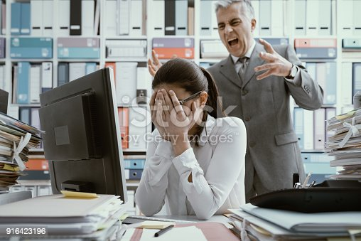 istock Angry boss yelling at his young employee 916423196