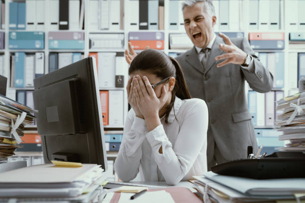 angry boss yelling at his young employee - aggression stock pictures, royalty-free photos & images