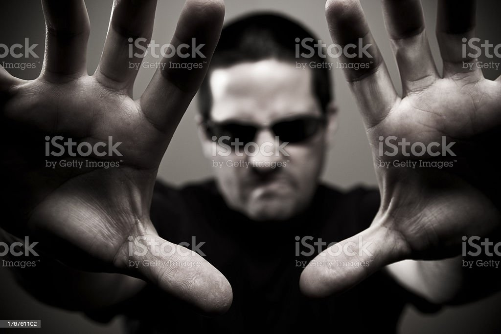 Angry bouncer reaches forward royalty-free stock photo