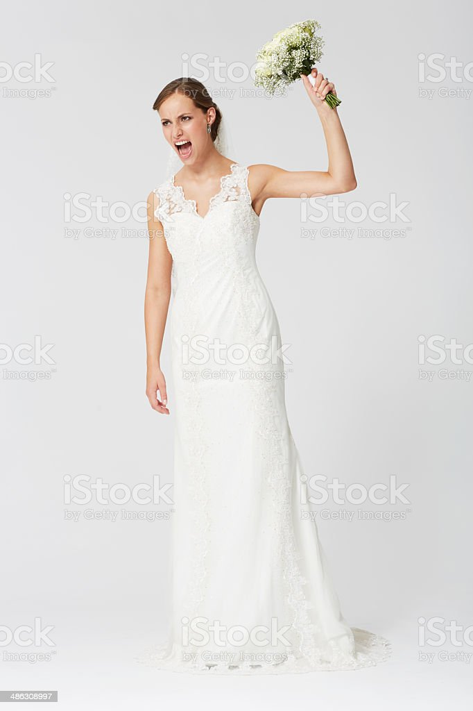 Angry bride left ready to throw the bouquet stock photo