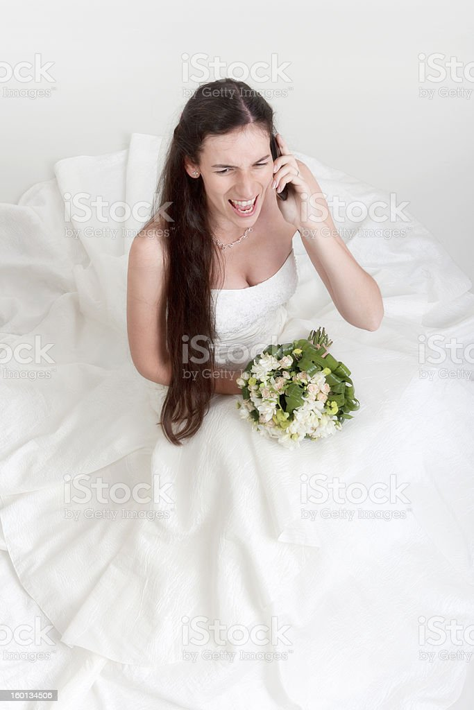 angry bride on cell phone royalty-free stock photo