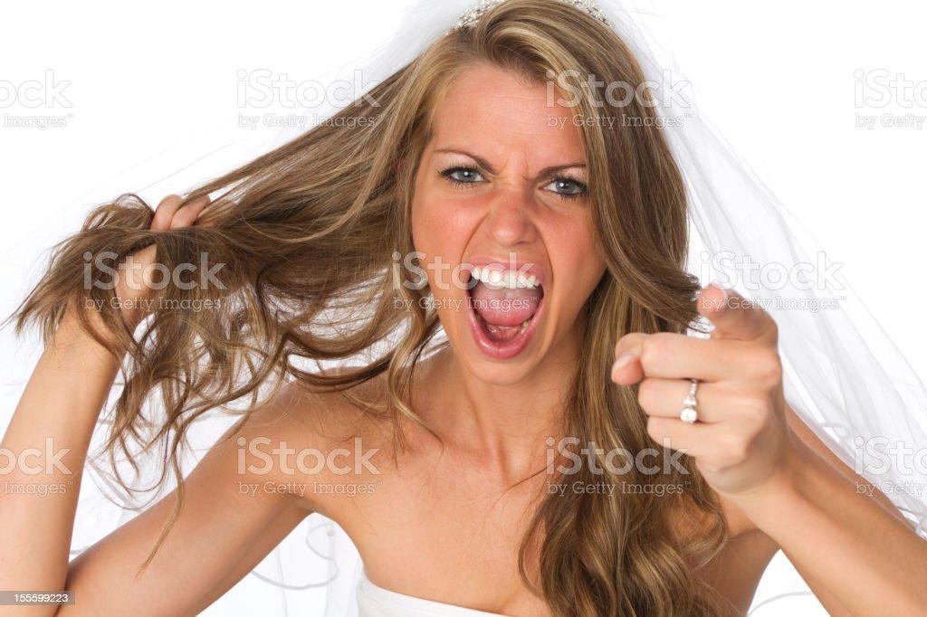 angry bride pointing at camera stock photo