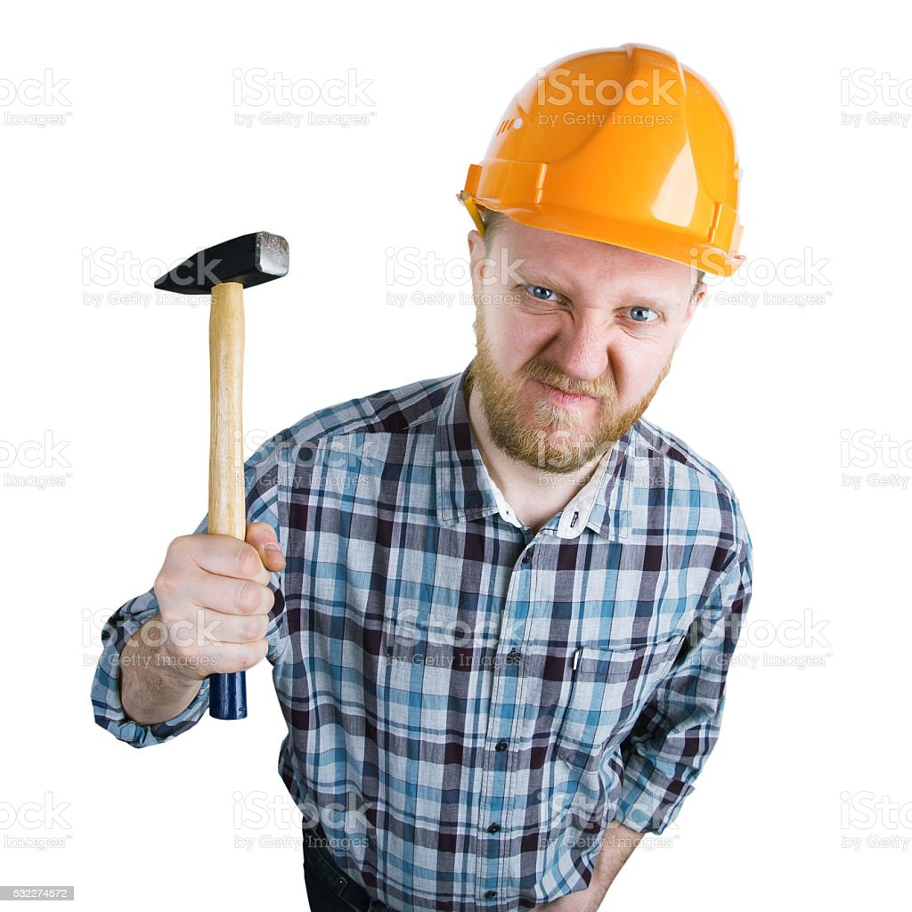 Angry builder iwith a hammer stock photo