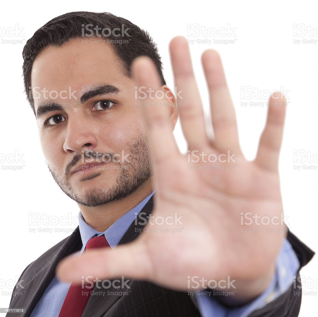 Angry business male showing stop sign against white royalty-free stock photo