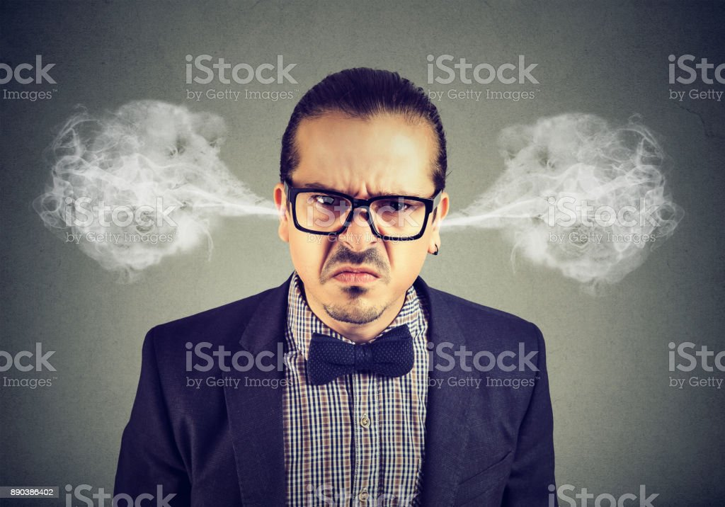 Angry business man, blowing steam coming out of ears, about to have...