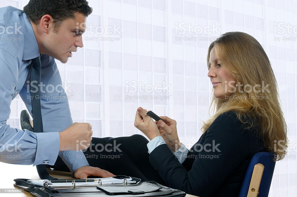 Angry Business Man Relaxed Female Coworker royalty-free stock photo