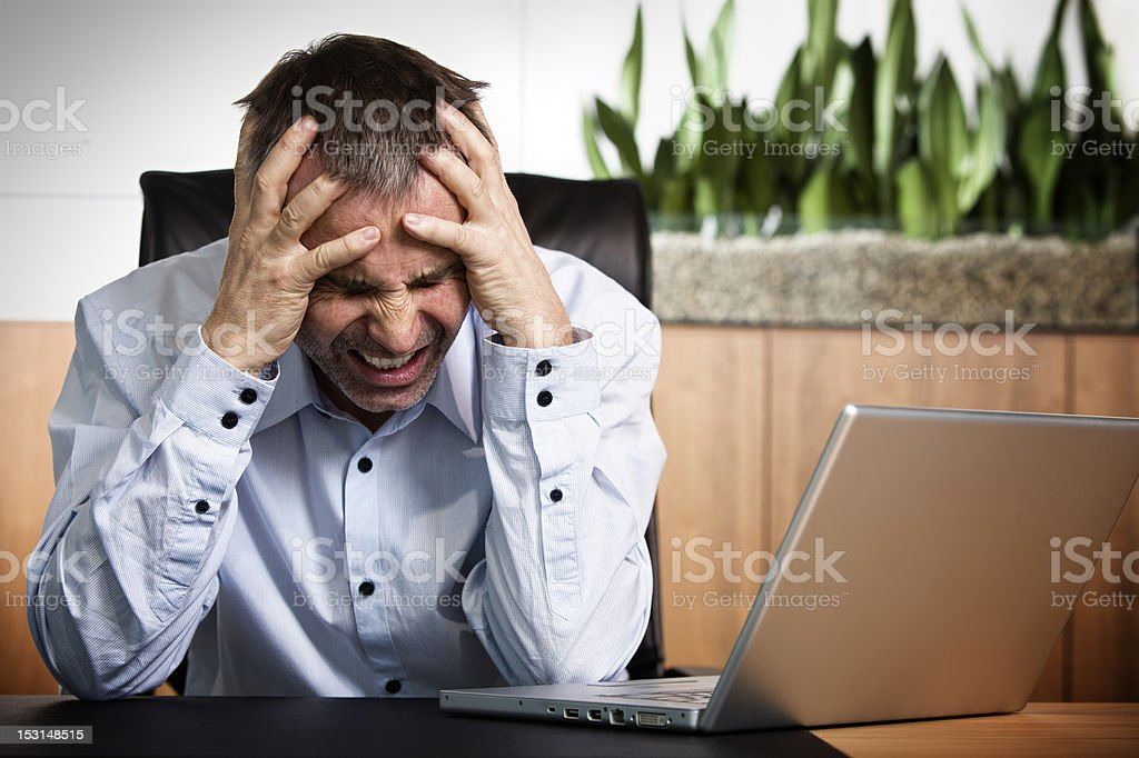 Angry business manager in front of office computer. royalty-free stock photo