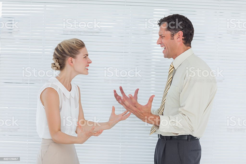 Angry business team having heated argument stock photo